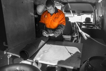 Technician performing onsite High Voltage HV Testing and Compliance Services